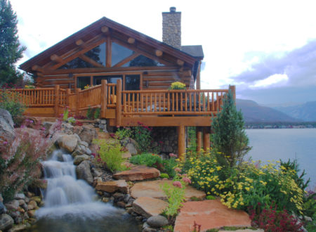 This log cabin on Shadow Mountain Lake/Grand Lake has wooden deck and stone fireplace over 50 steps of the flagstone over 100 separate waterfalls